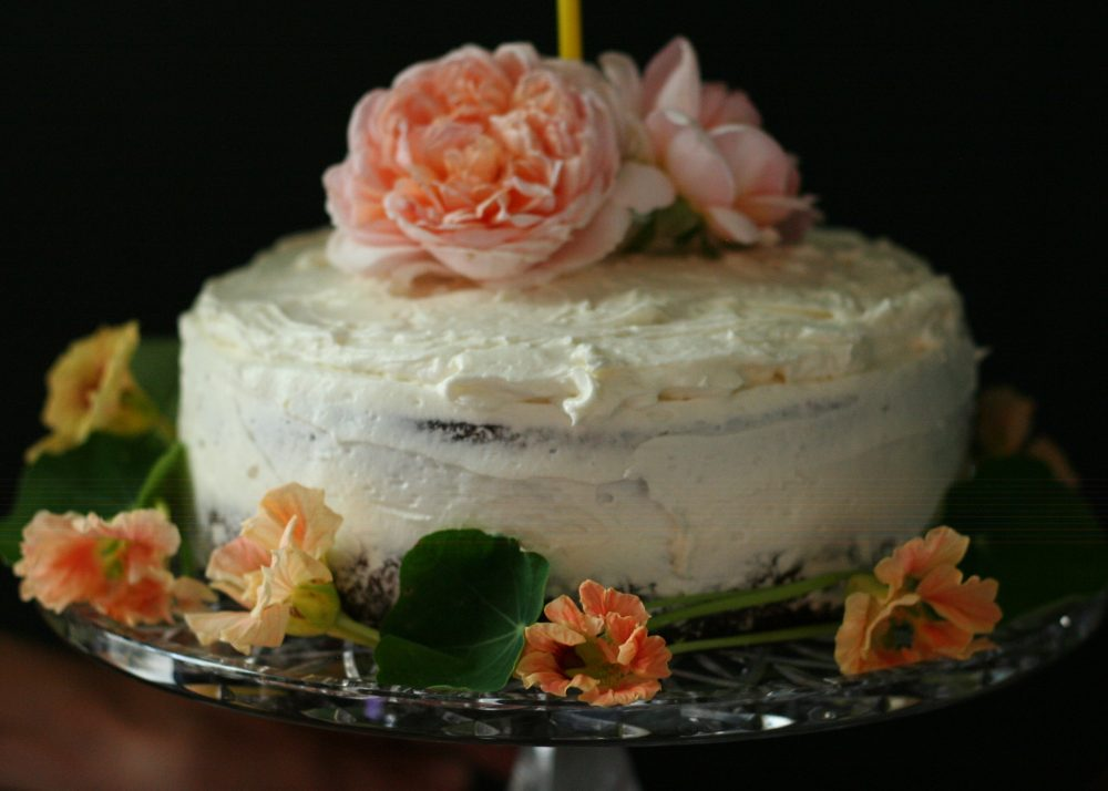 A Birthday Cake with roses and nasturtiums
